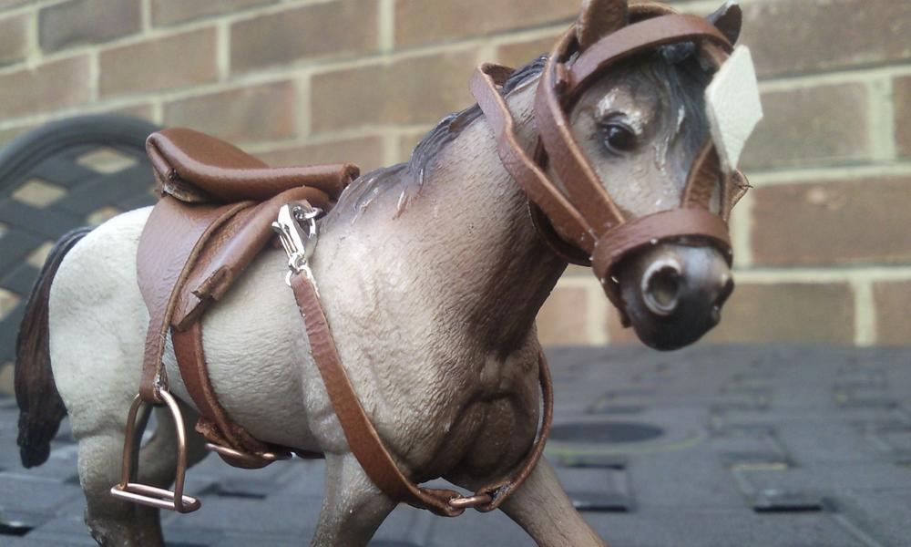 This is a leather saddle and bridle and i made a neckstrap to attach to the saddle with lobster clasps.