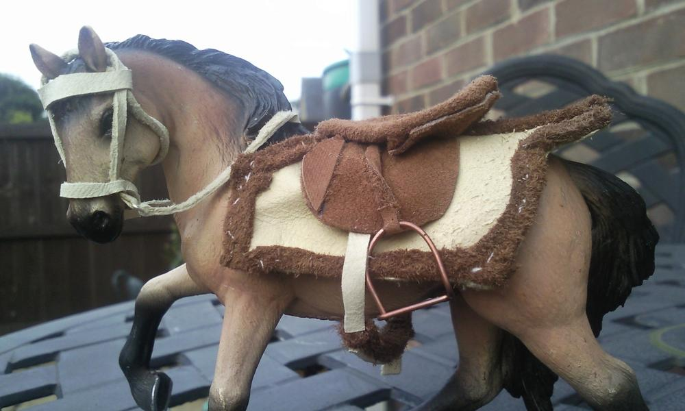 I made a complete set of tack in this particular style- this is an exercise rug made completely from leather and i used copper wire to make the shape for the saddle.